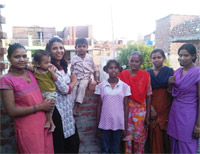 Liza and some of the team pictured with their children at their homes in a slum settlement on the outskirts of Chandigarh
